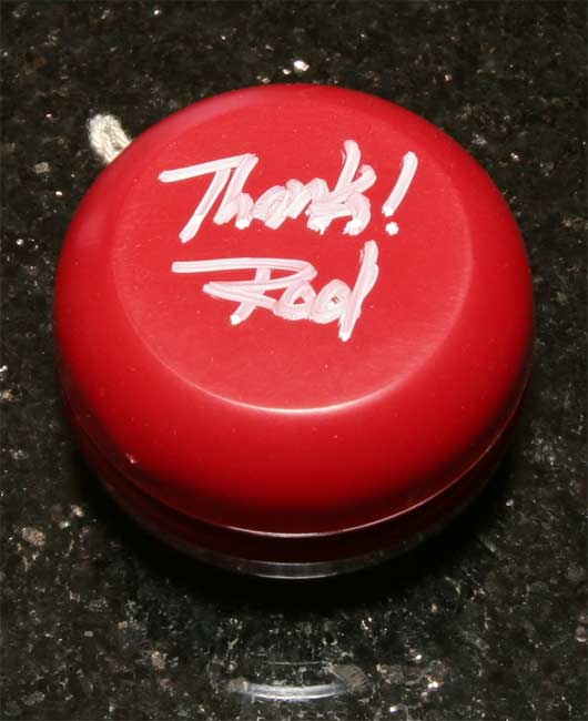 One hand-signed bright red AA yoyo
