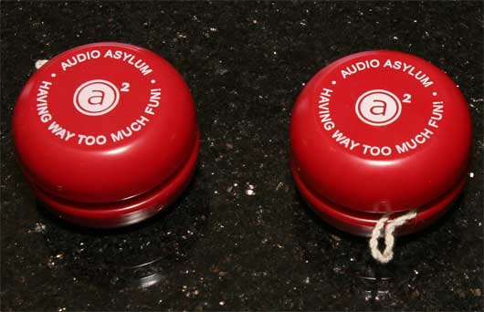Two bright red AA yoyos