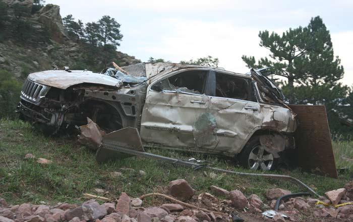 beat up car at the boulder flood